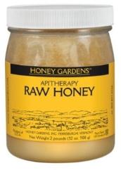 Raw honey in a glass bottle