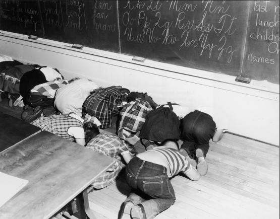 School kids learn how to take cover in the atomic age